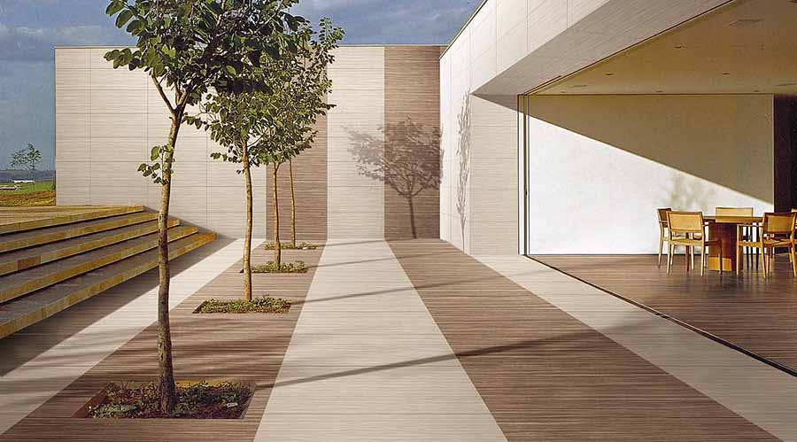 patio-of-a-contempoary-home-featuring-wood-effect-thin-porcelain-wall-and-floor-tiles